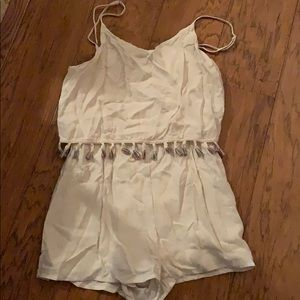 Cream romper with colorful tassels!